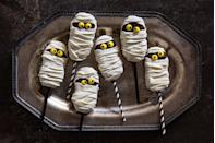 """<p>Here's how to turn a classic Nutter Butter into one very spooky treat.</p><p>Get the recipe from <a href=""""https://www.delish.com/cooking/recipes/a43937/mummy-pops-recipe/"""" rel=""""nofollow noopener"""" target=""""_blank"""" data-ylk=""""slk:Delish"""" class=""""link rapid-noclick-resp"""">Delish</a>.</p>"""