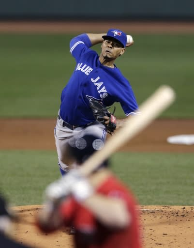 Toronto Blue Jays pitcher Esmil Rogers delivers against the Boston Red Sox during the first inning of a baseball game at Fenway Park in Boston, Friday, Sept. 20, 2013. (AP Photo/Charles Krupa)