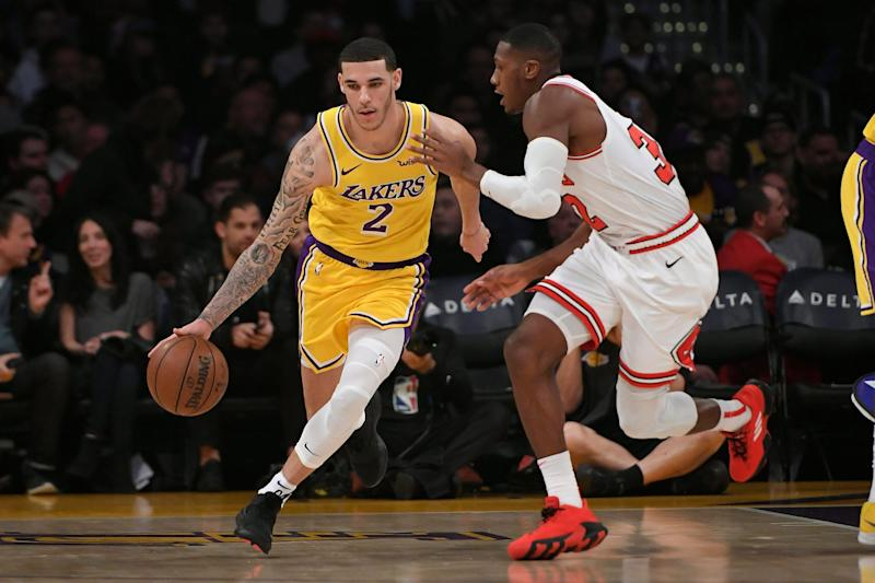 LOS ANGELES, CA - JANUARY 15: Lonzo Ball of the Los Angeles Lakers dribbles around Kris Dunn of the Chicago Bulls at Staples Center on January 15, 2019 in Los Angeles, California. NOTE TO USER: User expressly acknowledges and agrees that, by downloading and or using this photograph, User is consenting to the terms and conditions of the Getty Images License Agreement.(Photo by John McCoy/Getty Images)