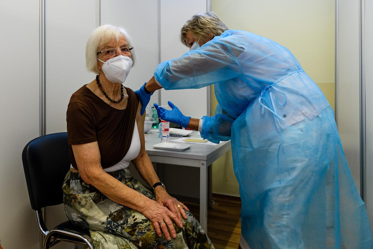 ERFURT, GERMANY - SEPTEMBER 15: Medical staff member inoculates an elderly patient with a booster inoculation of the Pfizer/BioNTech vaccine against Covid-19 on September 15, 2021 in Erfurt, Germany. Booster vaccinations, which are an additional vaccination shot given to strengthen an existing full vaccination, are underway across Germany for elderly patients who were among the first to receive shots in the initial vaccine rollout. (Photo by Jens Schlueter/Getty Images)