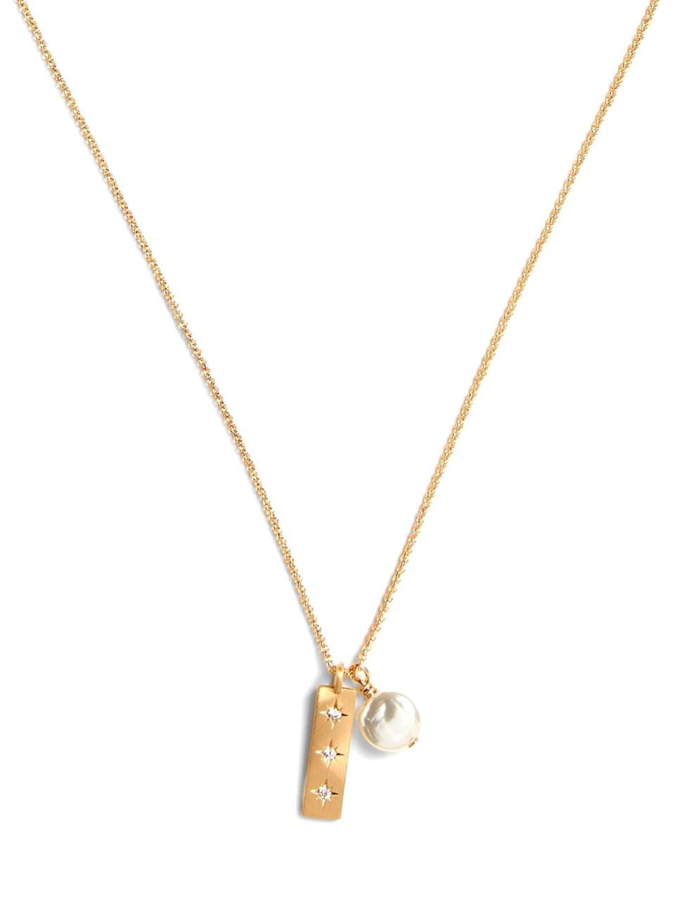 "<p>This <a href=""https://www.popsugar.com/buy/Banana-Republic-Pearl-amp-Bar-Necklace-528414?p_name=Banana%20Republic%20Pearl%20%26amp%3B%20Bar%20Necklace&retailer=bananarepublic.gap.com&pid=528414&price=38&evar1=fab%3Aus&evar9=36291197&evar98=https%3A%2F%2Fwww.popsugar.com%2Ffashion%2Fphoto-gallery%2F36291197%2Fimage%2F46988973%2FBanana-Republic-Pearl-Bar-Necklace&list1=shopping%2Choliday%2Cwinter%2Cgift%20guide%2Cwinter%20fashion%2Choliday%20fashion%2Cfashion%20gifts&prop13=api&pdata=1"" rel=""nofollow noopener"" class=""link rapid-noclick-resp"" target=""_blank"" data-ylk=""slk:Banana Republic Pearl & Bar Necklace"">Banana Republic Pearl & Bar Necklace</a> ($38) is so pretty.</p>"
