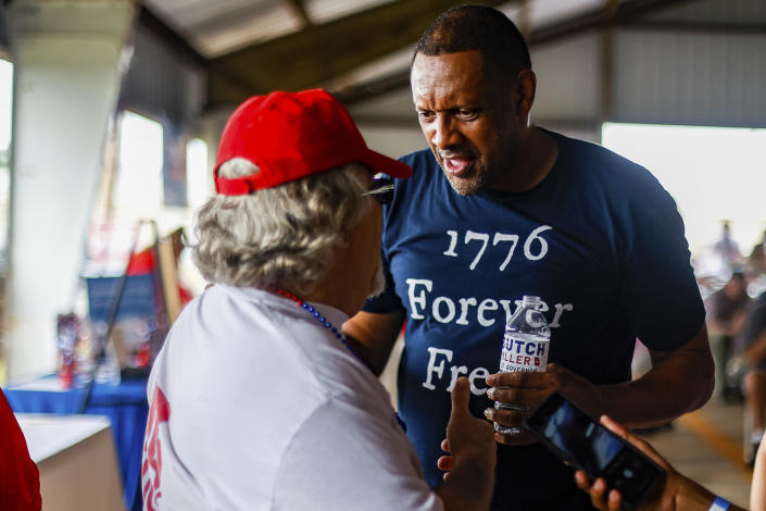 FILE - Georgia gubernatorial candidate Vernon Jones speaks to an attendee of the 17th annual Floyd County GOP Rally at the Coosa Valley Fairgrounds on Saturday, Aug. 7, 2021 in Rome, Ga. The rewards of an early Donald Trump endorsement will be on display Saturday, Sept. 25 in Georgia. A three-man ticket of candidates he's backing in 2022 Republican primaries for statewide office will take the stage with him. (Troy Stolt/Chattanooga Times Free Press via AP)