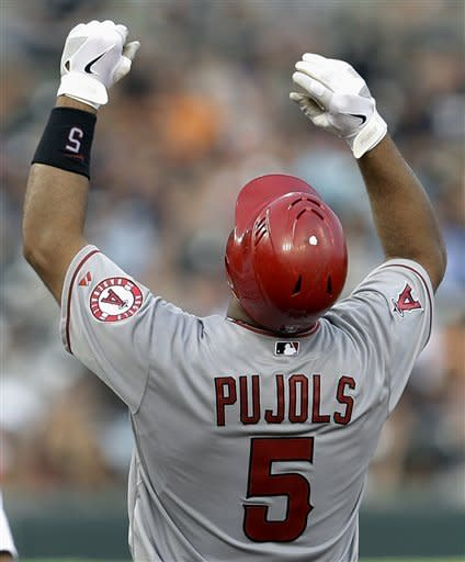 Los Angeles Angels' Albert Pujols celebrates an RBI double against the Detroit Tigers in the fifth inning of a baseball game in Detroit, Monday, July 16, 2012. (AP Photo/Paul Sancya)