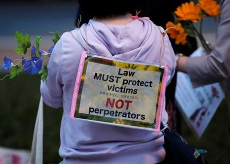 Protesters hold fowers at the rally called 'Flower Demo' to criticize recent acquittals in court cases of alleged rape in Japan and call for revision of the anti-sex crime law in Tokyo