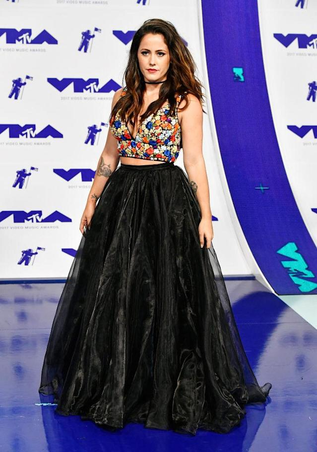 <p>The <em>Teen Mom</em> star paired a floral tank top with a large tulle skirt that showed off a bit of midriff. (Photo: Getty Images) </p>