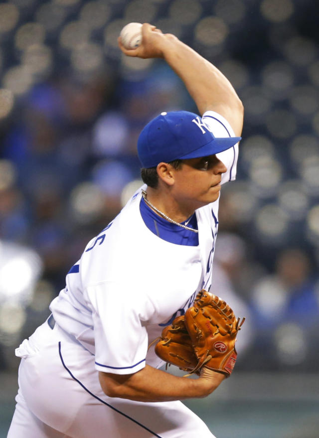 Kansas City Royals starting pitcher Jason Vargas delivers to a Toronto Blue Jays batter during the first inning of a baseball game in Kansas City, Mo., Tuesday, April 29, 2014. (AP Photo/Orlin Wagner)