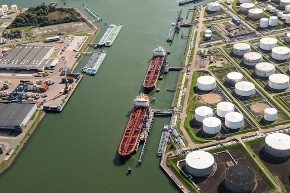 An aerial view of tankers at port.