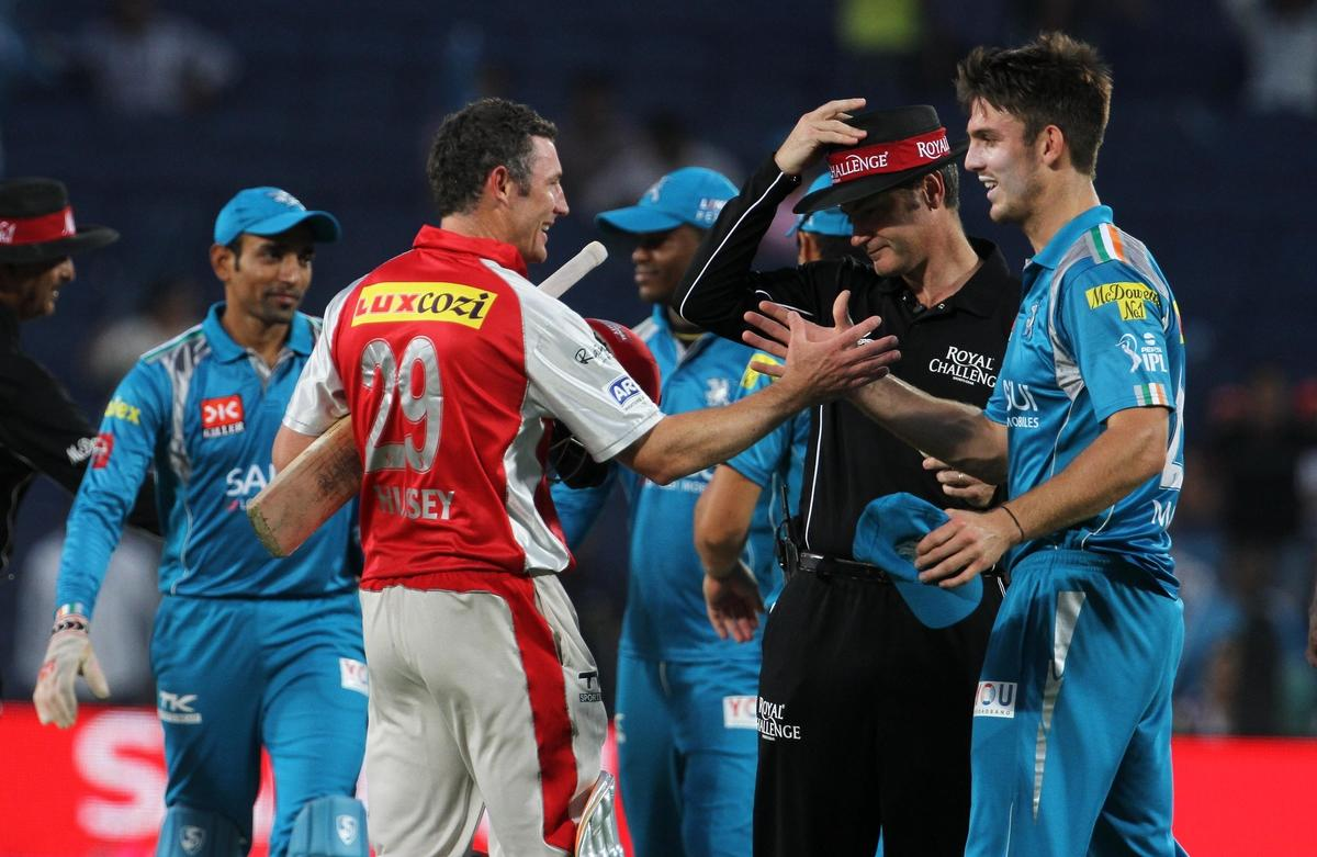 Kings XI Punjab player David Hussey shake hands with Pune Warriors player Mitchell Marsh after winning the match 6 of the the Pepsi Indian Premier League ( IPL) 2013  between The Pune Warriors India and the Kings XI Punjab held at the Subrata Roy Sahara Stadium, Pune on the 7th April  2013..Photo by Vipin Pawar-IPL-SPORTZPICS ..Use of this image is subject to the terms and conditions as outlined by the BCCI. These terms can be found by following this link:..https://ec.yimg.com/ec?url=http%3a%2f%2fwww.sportzpics.co.za%2fimage%2fI0000SoRagM2cIEc&t=1495730869&sig=7JaNbxs8dECUtgSKryj4Gg--~C