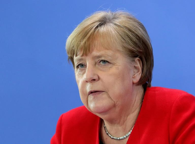 """Despite declaring the """"first phase"""" of the pandemic over in Germany, Chancellor Merkel must balance out the desire to relax restrictions with the knowledge new clusters have pushed the infection rate back up (AFP Photo/Michael Sohn)"""