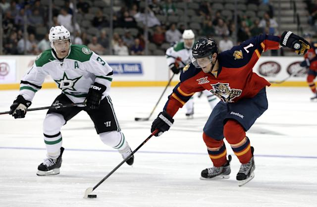 Dallas Stars' Stephane Robidas (3) gives chase as Florida Panthers' Dmitry Kulikov (7), of Russia, moves the puck upice during the second period of a preseason NHL hockey game on Wednesday, Sept. 18, 2013, in Dallas. (AP Photo/tony gutierrez)