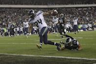 Seattle Seahawks' Marshawn Lynch (24) scores a touchdown past Philadelphia Eagles' Nate Allen (29) during the second half of an NFL football game, Sunday, Dec. 7, 2014, in Philadelphia. (AP Photo/Michael Perez)