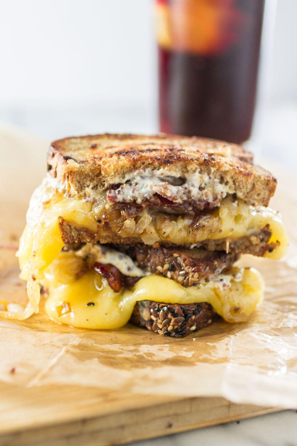 """<p>With gouda, caramelized onions, and maple whiskey bacon, this is one statement-making grilled cheese sandwich.</p><p>Get the recipe from <a href=""""http://www.oliviascuisine.com/trainwreck-grilled-cheese/"""" rel=""""nofollow noopener"""" target=""""_blank"""" data-ylk=""""slk:Olivia's Cuisine"""" class=""""link rapid-noclick-resp"""">Olivia's Cuisine</a>.</p>"""