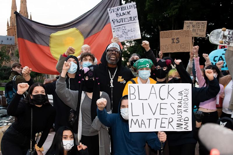 SYDNEY, AUSTRALIA - JUNE 02: Protesters shout slogans and hold up signs in Hyde Park during a 'Black Lives Matter' rally on 02 June, 2020 in Sydney, Australia. This event was organized to rally against aboriginal deaths in custody in Australia as well as in unity with protests across the United States following the killing of a Black man George Floyd at the hands of a police officer in Minneapolis, Minnesota. (Photo by Speed Media/Icon Sportswire) (Photo: Icon Sportswire via Getty Images)
