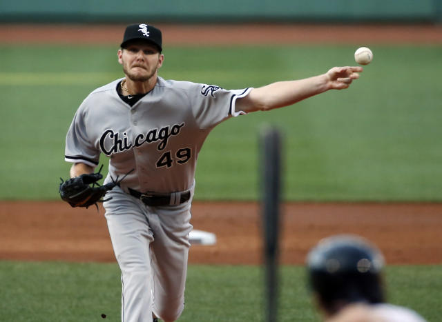Chicago White Sox starting pitcher Chris Sale delivers to the Boston Red Sox in the first inning of a baseball game at Fenway Park in Boston, Wednesday, July 9, 2014. (AP Photo/Elise Amendola)