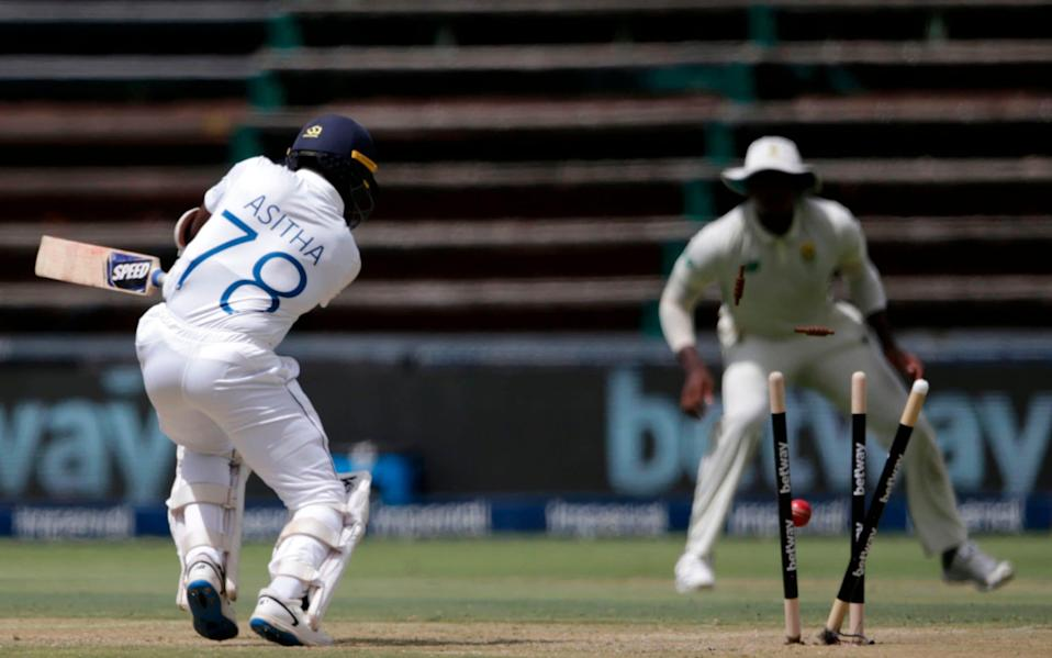 Sri Lanka's Asitha Fernando is bowled by South Africa's Anrich Nortje (not visible) during the first day of the second Test cricket match between South Africa and Sri Lanka at the Wanderers stadium in Johannesburg on January 3, 2021 - AFP/PHILL MAGAKOE