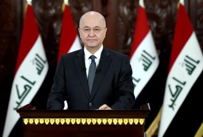 Iraq's President Barham Salih delivers a televised speech to people in Baghdad