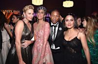 <p>Pharrell Williams found himself surrounded by a bevy of beauties at the <i>Vanity Fair</i> bash: (from L-R) Charlize Theron, his wife, Helen Lasichanh, and Salma Hayek. (Photo by Kevin Mazur/VF17/WireImage) </p>