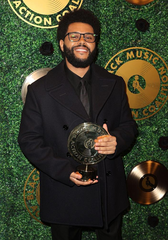 <p>The Weeknd shows off his new hardware on Sept. 23 after accepting the Quincy Jones Humanitarian Award from the Black Music Action Coalition at the Music in Action Awards at 1 Hotel West Hollywood. </p>