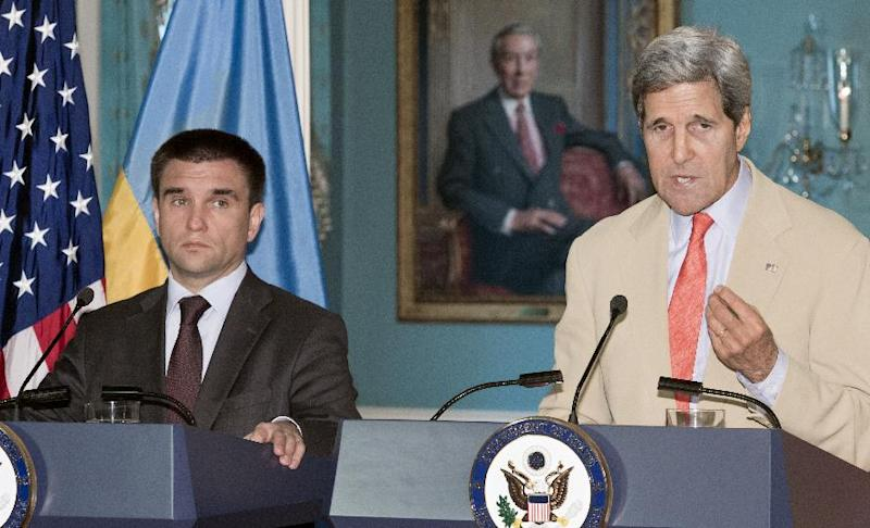 US Secretary of State John Kerry delivers remarks with Ukrainian Foreign Minister Pavlo Klimkin during a press conference on July 29, 2014 in Washington, DC (AFP Photo/Paul J. Richards)
