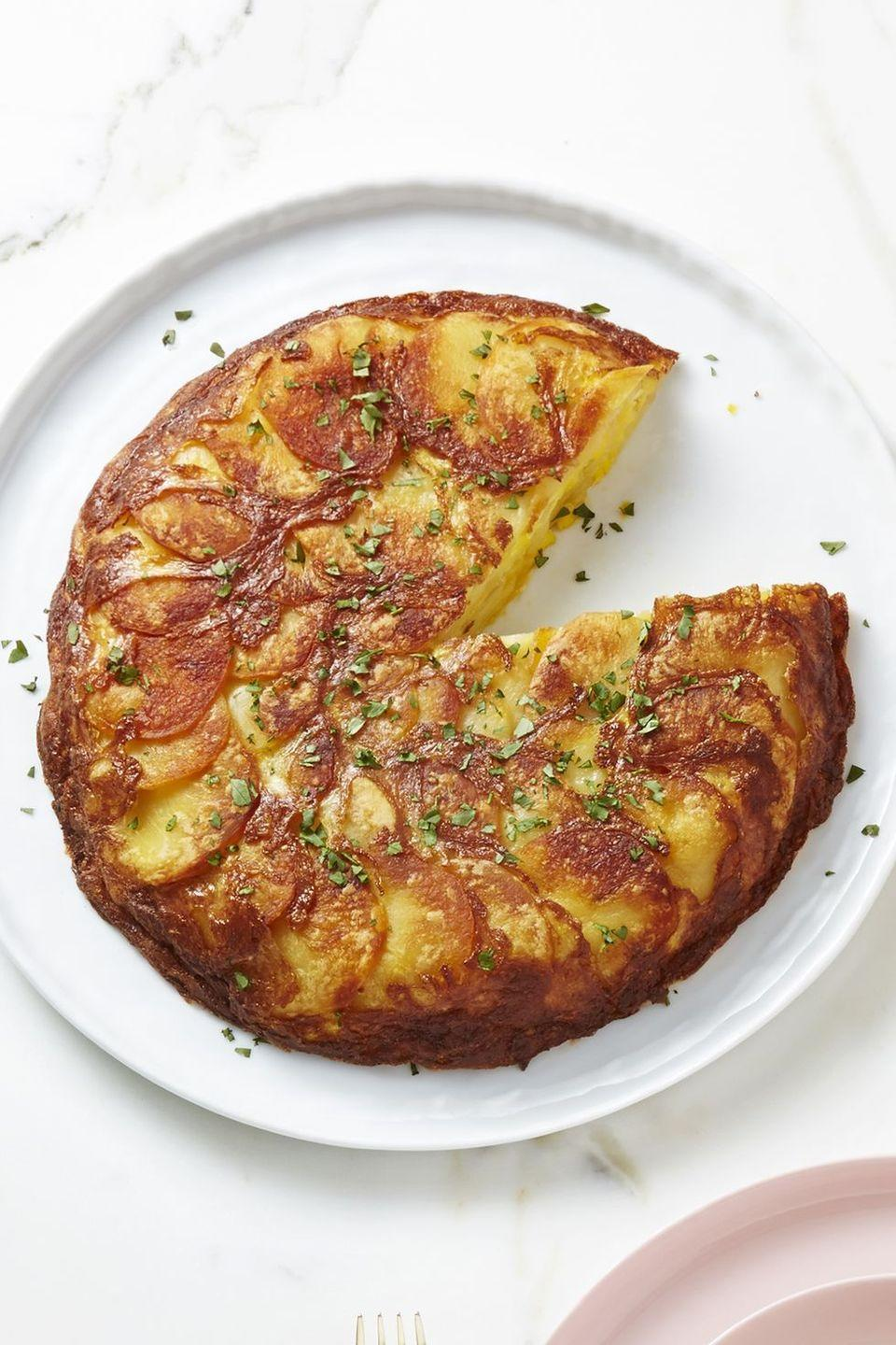 """<p>In my humble opinion, every omelette should contain crispy, oven baked potatoes. </p><p><a href=""""https://www.goodhousekeeping.com/food-recipes/a43177/spanish-potato-omelet-recipe/"""" rel=""""nofollow noopener"""" target=""""_blank"""" data-ylk=""""slk:Get the recipe for Spanish Potato Omelet »"""" class=""""link rapid-noclick-resp""""><em>Get the recipe for Spanish Potato Omelet »</em></a></p>"""