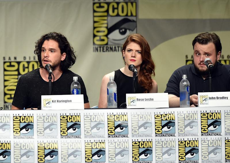 "(L-R) Actors Kit Harington, Rose Leslie and John Bradley at the ""Game Of Thrones"" panel during Comic-Con International in San Diego on July 25, 2014 (AFP Photo/Kevin Winter)"