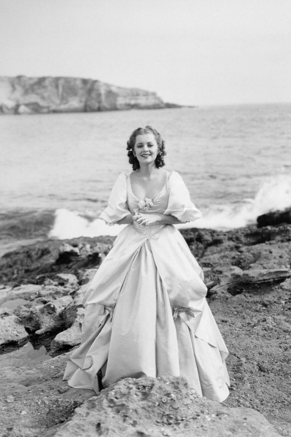 <p>In a luscious gown for a beachside photo shoot. </p>
