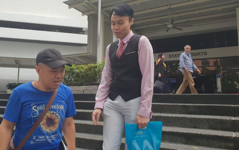 Daniel Augustin De Costa (centre), 35, is charged for one count of criminal defamation and another count of unauthorised access to computer material. (PHOTO: Koh Wan Ting)