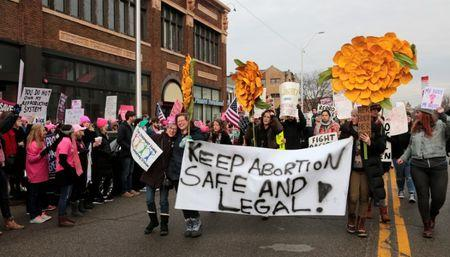 Supporters of Planned Parenthood rally outside a Planned Parenthood clinic in Detroit, Michigan