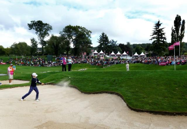 FILE PHOTO: Ryu of South Korea chips the ball out of a bunker onto the 18th green during the final round of the women's Evian Championship golf tournament in Evian