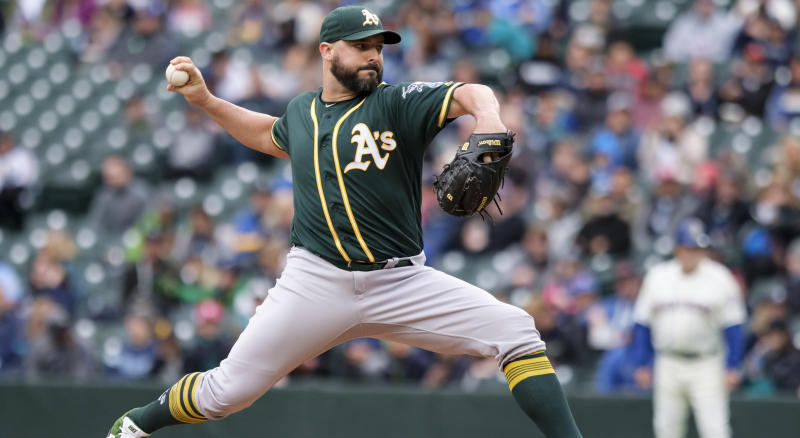 SEATTLE, WA - SEPTEMBER 29: Starter Tanner Roark #60 of the Oakland Athletics delivers a pitch during the first inning of a game against the Seattle Mariners at T-Mobile Park on September 29, 2019 in Seattle, Washington. (Photo by Stephen Brashear/Getty Images) *** Local Caption *** Tanner Roark