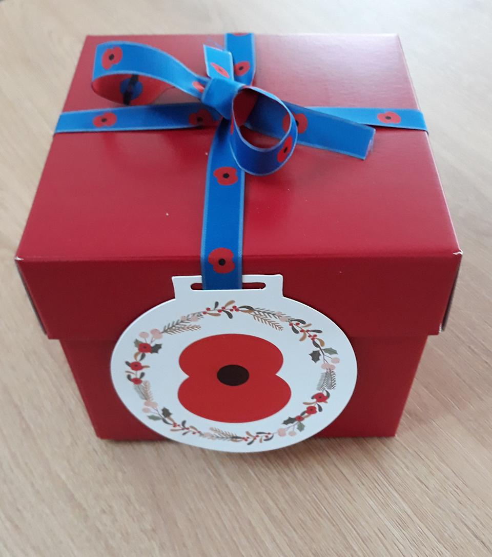 EMBARGOED TO 2200 MONDAY DECEMBER 21 Undated handout photo issued by the Royal British Legion of a gift box containing one of the Christmas puddings made by members of the royal family at Buckingham Palace in 2019. The Royal British Legion has gifted 99 Christmas puddings mixed by four generations of the Royal Family to members of the Armed Forces community across the UK and overseas as part of its 'Together at Christmas' initiative.