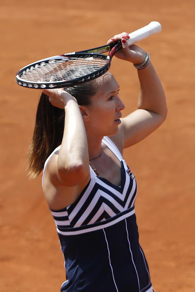Serbia's Jelena Jankovic holds her racket above her head after missing a return during the third round match of the French Open tennis tournament against Romania's Sorana Cirstea at the Roland Garros stadium, in Paris, France, Saturday, May 31, 2014. (AP Photo/Darko Vojinovic)