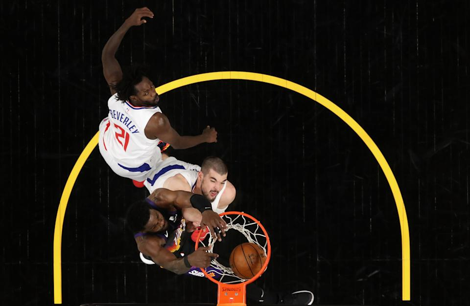 Suns star DeAndre Ayton throws down the game-winning dunk over the Clippers' defense with 0.7 seconds left in Game 2 of the Western Conference finals. (Christian Petersen/Getty Images)