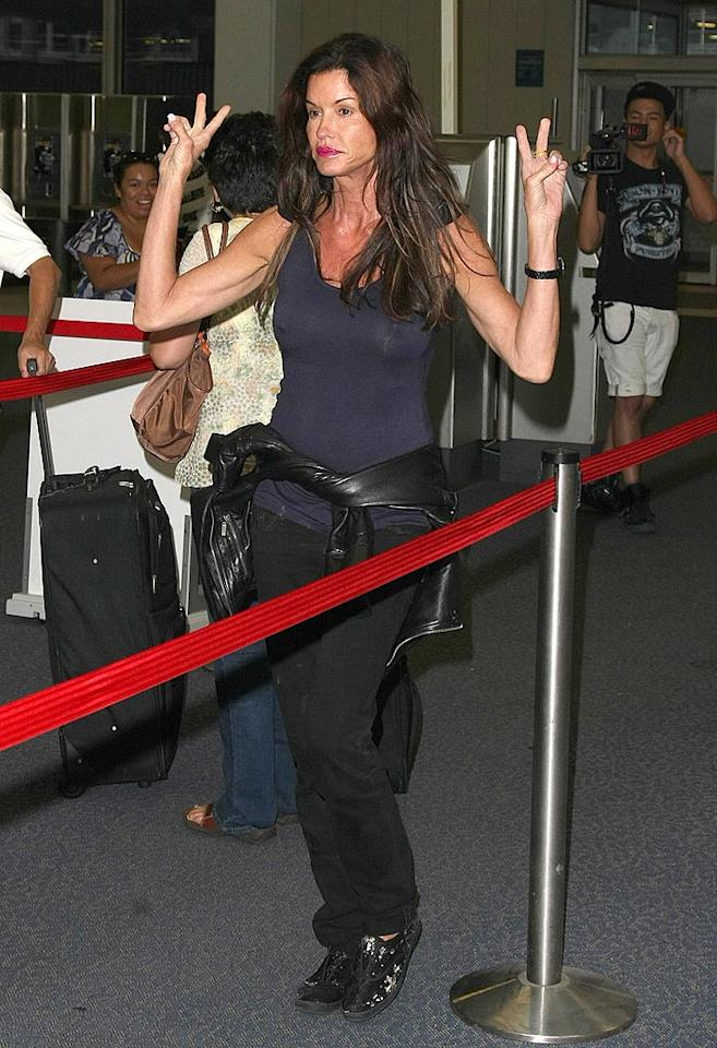 "The 55-year-old peaces out while making her way through security. Daniel/Harding/<a href=""http://www.infdaily.com"" target=""new"">INFDaily.com</a> - June 27, 2010"