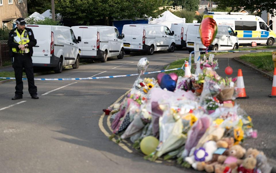 Flowers were laid outside the home in Killamarsh, Sheffield - Tom Maddick/SWNS