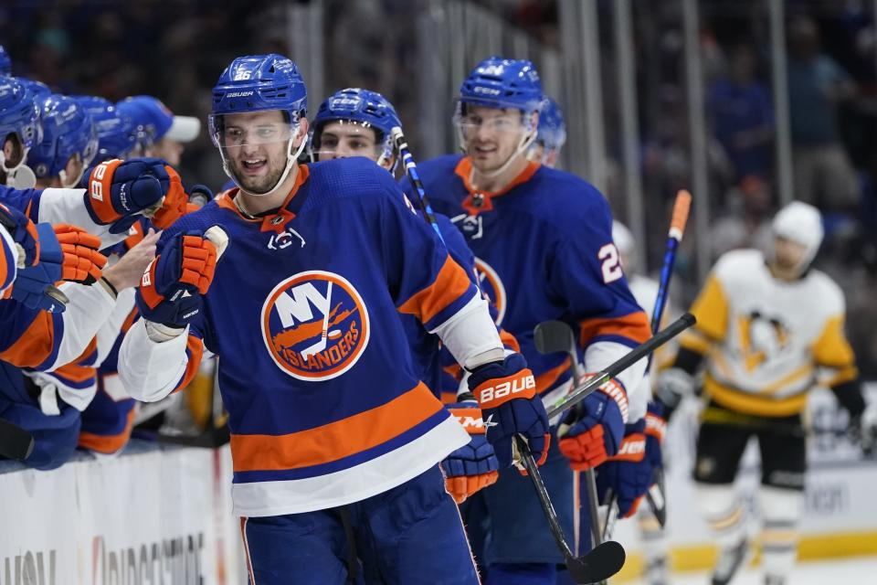 New York Islanders' Oliver Wahlstrom (26) celebrates with teammates after scoring a goal during the third period of Game 4 of an NHL hockey Stanley Cup first-round playoff series against the Pittsburgh Penguins, Saturday, May 22, 2021, in Uniondale, N.Y. The Islanders won 4-1. (AP Photo/Frank Franklin II)