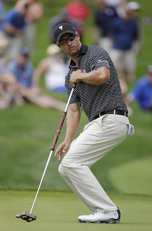 International team player Adam Scott, of Australia, reacts to a missed putt on the fourth hole during a foursome match at the Presidents Cup golf tournament at Muirfield Village Golf Club, Friday, Oct. 4, 2013, in Dublin, Ohio. (AP Photo/Darron Cummings)