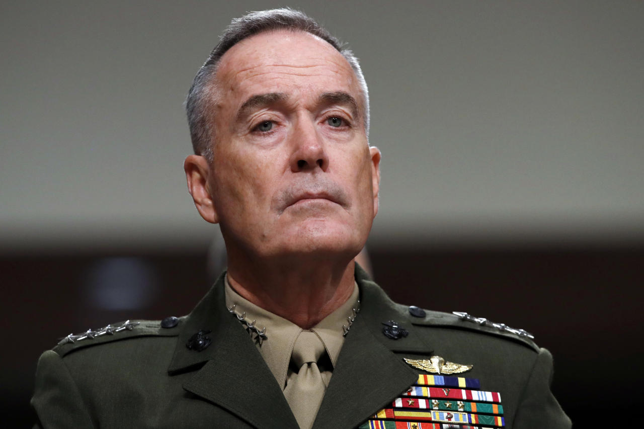 "FILE - In this June 13, 2017, file photo. Joint Chiefs Chairman Gen. Joseph Dunford listens on Capitol Hill in Washington. Military chiefs will seek a six-month delay before letting transgender people enlist in their services, officials said June 23. Dunford told a Senate committee there have been some issues identified with recruiting transgender individuals that ""some of the service chiefs believe need to be resolved before we move forward."" He said Mattis was reviewing the matter. (AP Photo/Jacquelyn Martin, File)"