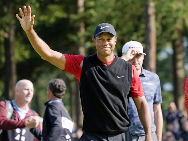 FILE PHOTO: Tiger Woods celebrates to win the final round of the Zozo Championship, a PGA Tour event, at Narashino Country Club in Inzai, Japan