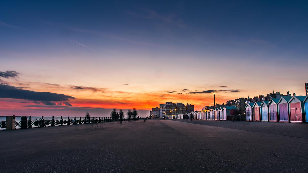 The beautiful beach huts at Hove are the perfect backdrop for a sundowner. (Getty Images)
