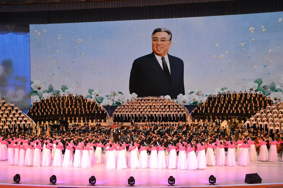 Massed choirs and dancers perform a lavish spectacular as part of the celebrations. Each time an image of one of the Kims appears on the giant screen, the North Koreans in the audience applaud spontaneously. We clap politely at first, but the applause feels oppressive as the show wears on. I think of how Soviet citizens would give an ovation at every mention of Stalin's name. (The gulag awaited those who didn't applaud.) Almost all popular North Korean entertainment, even pop music, is in praise of the nation and the Kims.
