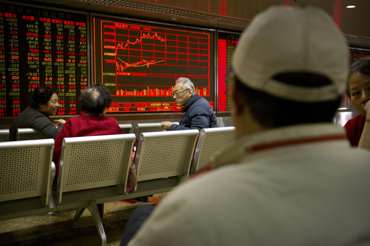Chinese investors monitor stock prices at a brokerage house in Beijing, Wednesday, Nov. 22, 2017. Asian stocks rose Wednesday after Wall Street hit new highs ahead of the two-day U.S. break for the Thanksgiving holiday. (AP Photo/Mark Schiefelbein)