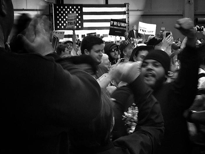 <p>Protesters tangle with Trump supporters as the candidate speaks on stage during a rally on March 4 in New Orleans. (Photo: Holly Bailey/Yahoo News) </p>
