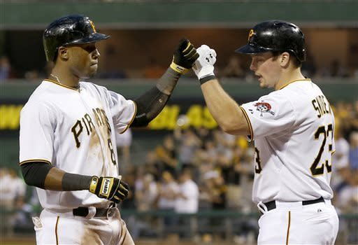 Pittsburgh Pirates' Starling Marte, left, is greeted by Travis Snider after hitting a home run in the sixth inning of the baseball game against the San Francisco Giants on Tuesday, June 11, 2013, in Pittsburgh. (AP Photo/Keith Srakocic)