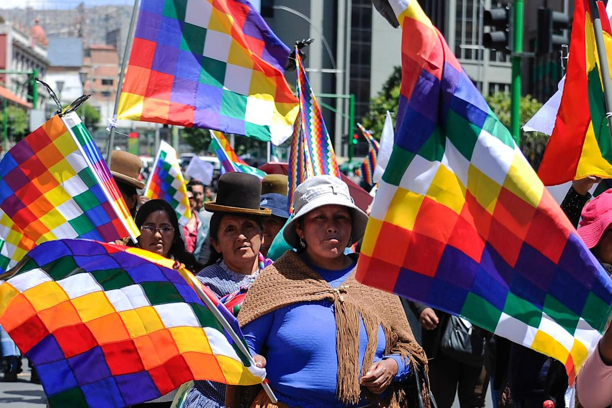Supporters of Evo Morales carry Wiphala flags that represent Indigenous peoples in La Paz on Nov. 18, 2019. (Photo: JORGE BERNAL via Getty Images)