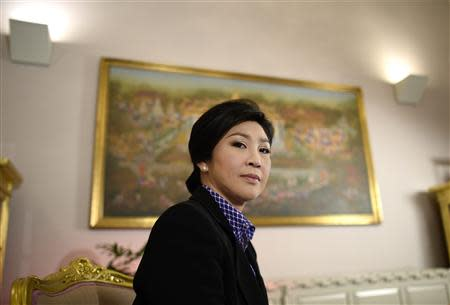 Thai Prime Minister Yingluck Shinawatra poses for a picture during an interview with foreign media at the Government House in Bangkok December 7, 2013. REUTERS/Dylan Martinez