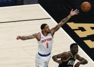 New York Knicks' Obi Toppin (1) scores against Atlanta Hawks' Clint Capela (15) during the first half in Game 4 of an NBA basketball first-round playoff series Sunday, May 30, 2021, in Atlanta. (AP Photo/Brynn Anderson)