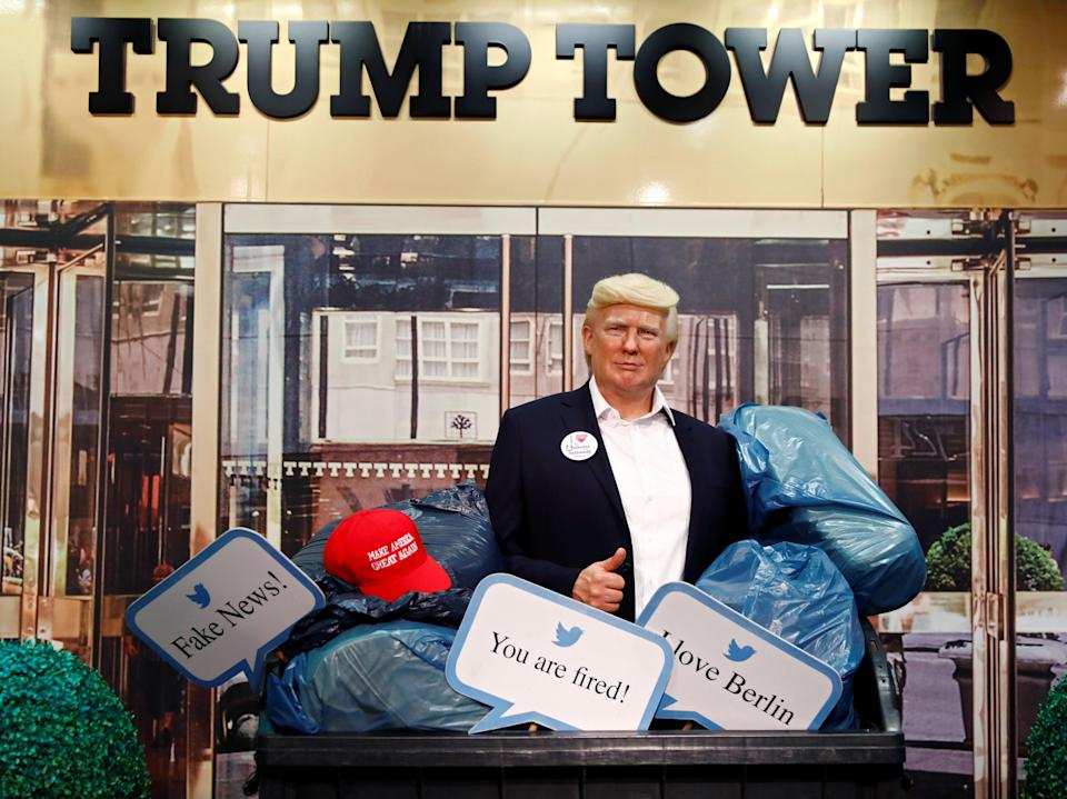 <p>A wax figure depicting U.S. President Donald Trump is put into a dumpster at Madame Tussauds in Berlin, Germany, on 30 October2020</p> ((Reuters))