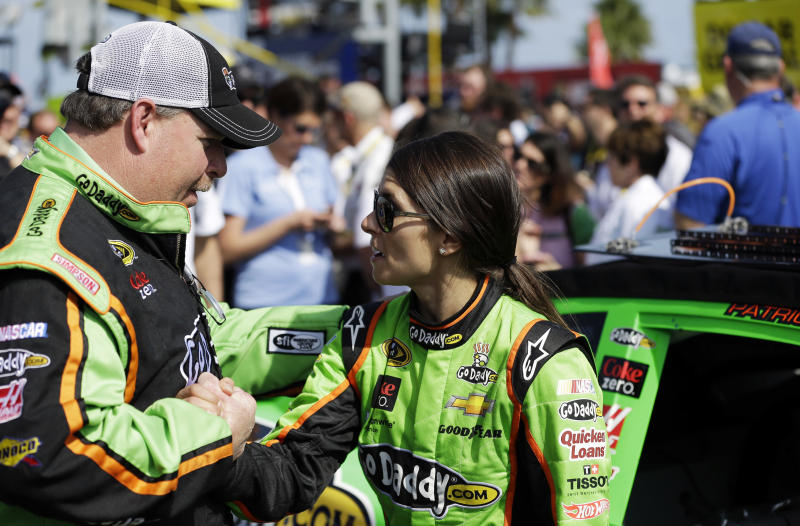 Crew chief Tony Gibson, left, shakes hands with driver Danica Patrick before she gets in the car to run in the first of two 150-mile qualifying races for the NASCAR Daytona 500 auto race at Daytona International Speedway, Thursday, Feb. 21, 2013, in Daytona Beach, Fla. (AP Photo/John Raoux)