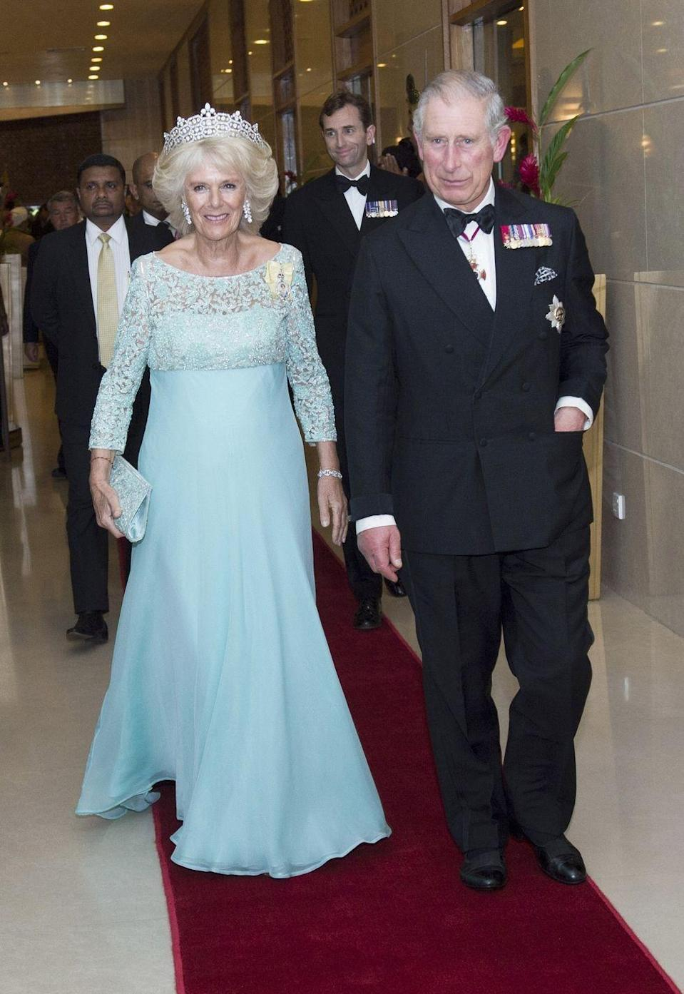<p>Camilla wore a rick lace and chiffon gown in light blue along with a tiara for a welcome dinner for her and Prince Charles in Colombo, Sri Lanka. </p>